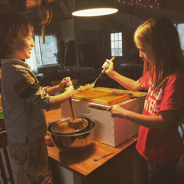 The kids and I learning how to process honey from our collapsed bee hive.